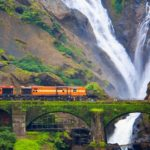 Dudhsagar_falls_with_train-holidayscrowd